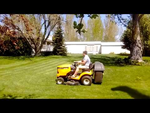 Mowing the Lawn with riding mower and bagger